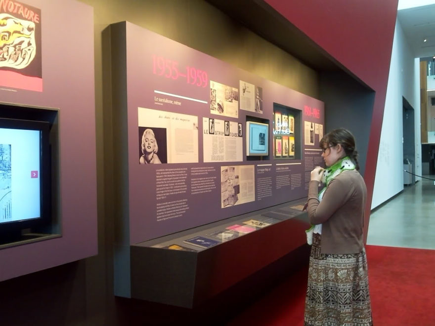 Surrealism interactive area with section discussing various surrealist publications